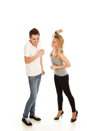 spat: Young woman giving a punch to her boyfriend Stock Photo