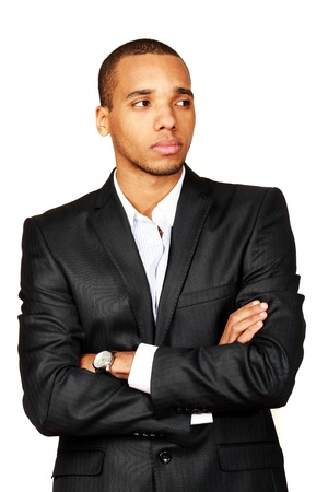 looking aside: Portrait of a happy African-American young businessman looking aside isolated over white background Stock Photo