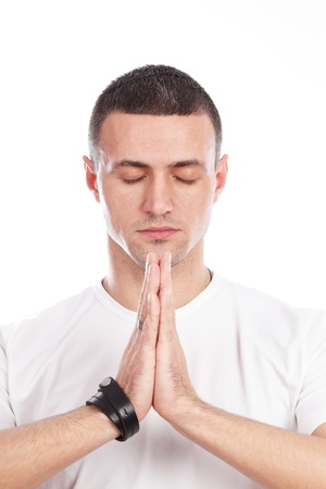 business man praying over white background photo