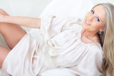 Beautiful woman lying down on her bed at home Stock Photo - 9282514