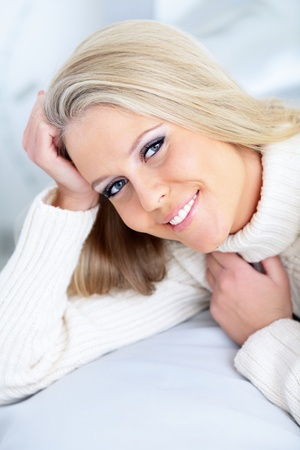 Closeup portrait of a happy young lady in relaxed pose photo