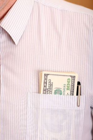 Close up of a shirt with one hundred dollar banknotes in the pocket photo