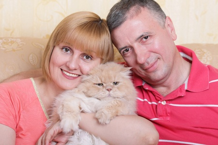 A cute family enjoying their life with a fluffy big cat Stock Photo - 9283029