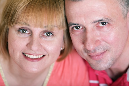 Wife and husband in middle age smiling photo