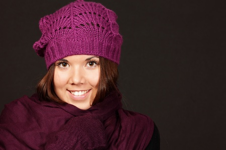smiling young woman isolated in purple hat photo