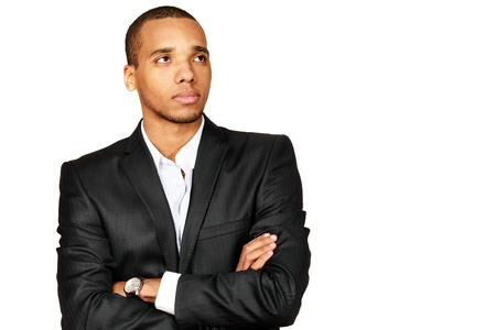 look at right: Portrait of a happy African-American young businessman looking aside and up isolated over white background