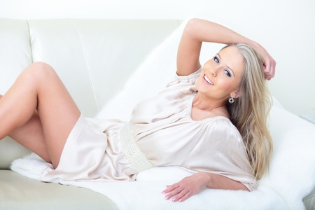 woman lying down: Beautiful woman lying down on her bed at home