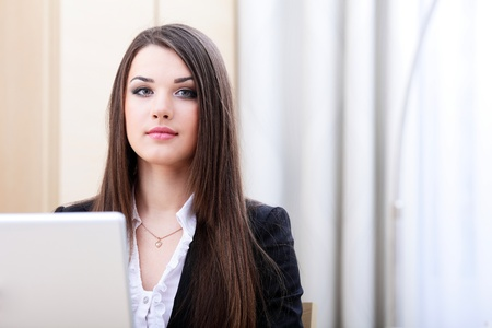 Attractive young business woman using laptop Stock Photo - 9365403