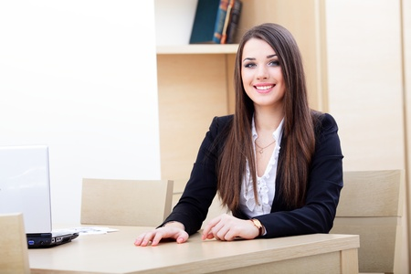 Attractive young business woman using laptop Stock Photo - 9283317