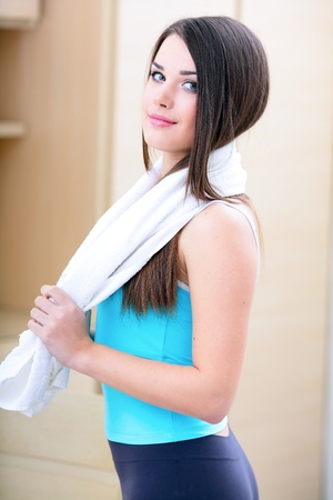 gym girl: Beautiful young sport woman with towel Stock Photo