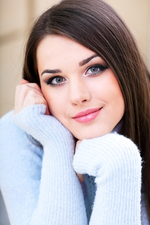 Portrait of a young cute woman in warm sweater Stock Photo