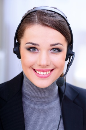 Beautiful call center operator with headset. Stock Photo - 9365431