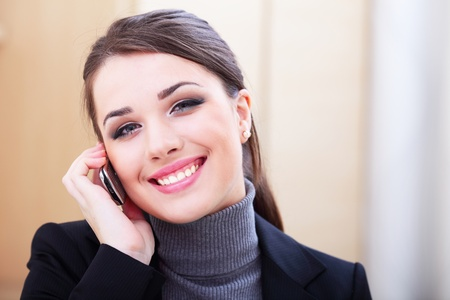 Happy successful businesswoman with cell phone Stock Photo - 9283401