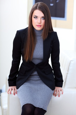 Attractive businesswoman siting on the chair in office photo