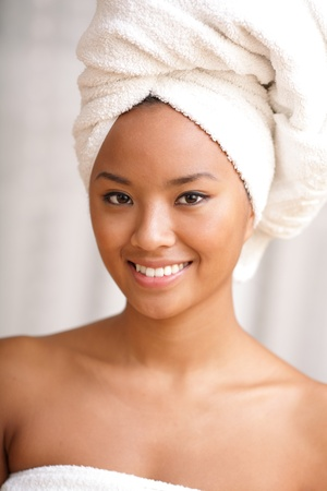 Closeup portrait of young beautiful woman after bath photo