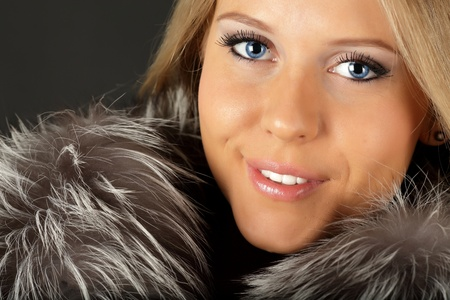 Happy beautiful woman in fur clothing photo