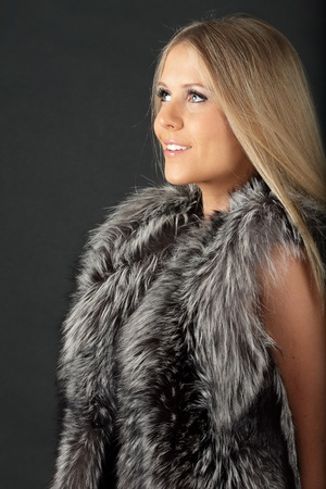 Beautiful Young dreamy woman in fur photo