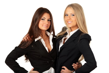 teambuilding: Two businesswomen collegues hugging isolated on white