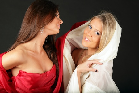 2 women in fabric expressing opposite characters photo