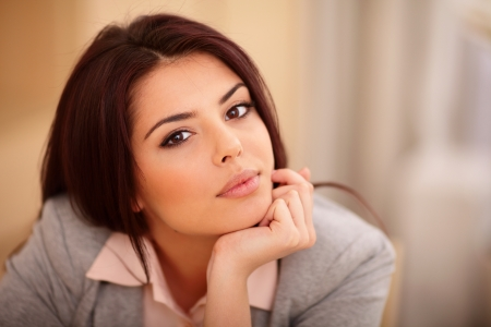 Closeup portrait of a Young beautiful confident woman photo