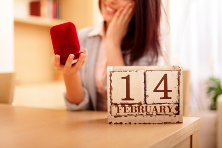 Young woman getting her present on valentine photo
