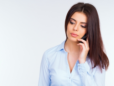 Beautiful pensive business woman talking on the phone photo