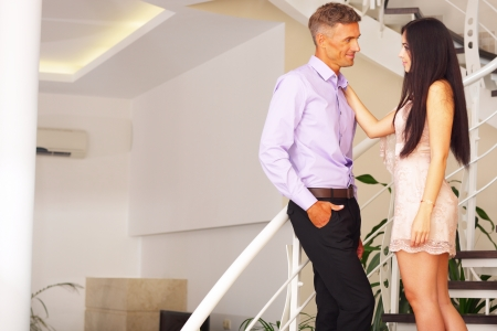Image of a young lovely couple at home photo