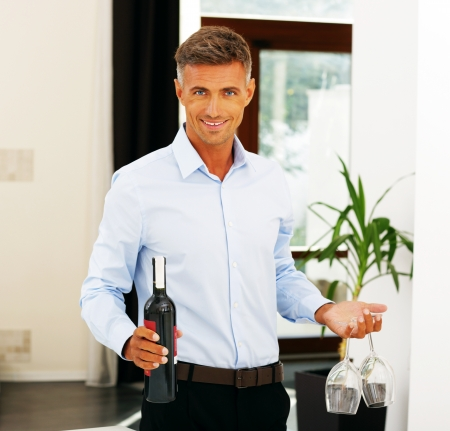 Handsome happy romantic man with a bottle of wine photo