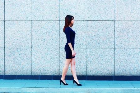 Young attractive businesswoman walking  photo