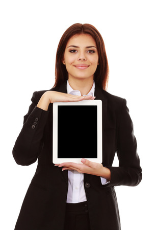 Beautiful young businesswoman showing a display of electronic tablet photo