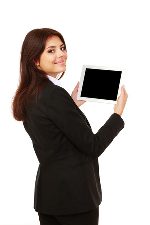 Beautiful young businesswoman showing a display of electronic tablet