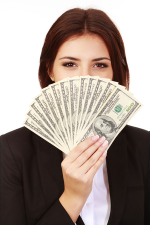 Happy businesswoman covering her face with dollars photo