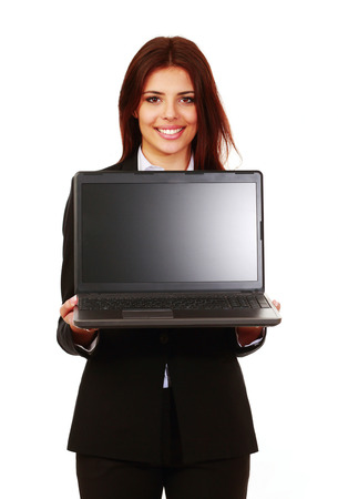 Smiling businesswoman showing computer display over white background photo