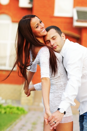 Happy couple standing in front of new home Stock Photo - 22614170