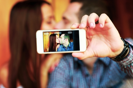 romantic picture: Couple taking self-portrait  photos with mobile smart phone