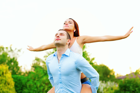 Happy attractive couple enjoying their lifes outdoors photo