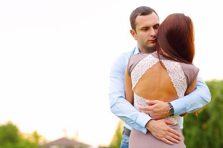 Embracing couple hugging photo