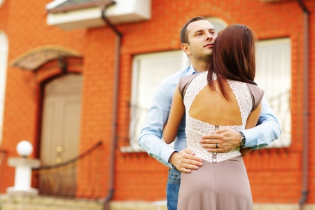 Happy couple standing in front of new home Stock Photo - 22614193