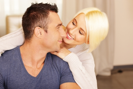 Happy beautiful  couple bonding at home Stock Photo - 23948583