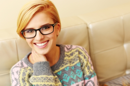 Closeup portrait of a young cheerful woman in glasses  photo