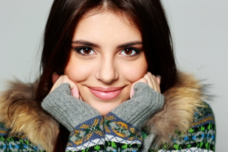 Closeup portrait of a young thoughtful woman in warm winter outfit  Stock Photo - 24600412
