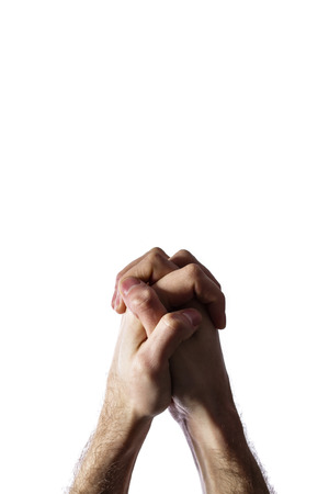 Hands clasped together for a prayer  isolated on a white background photo