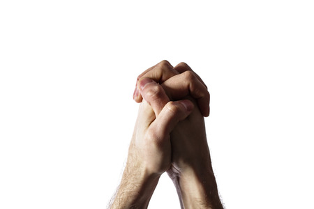 Hands clasped together for a prayer  isolated on a white background Stock Photo - 25072695