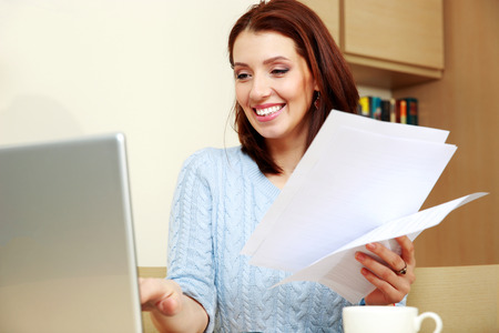 work clothes: Smiling woman working at home
