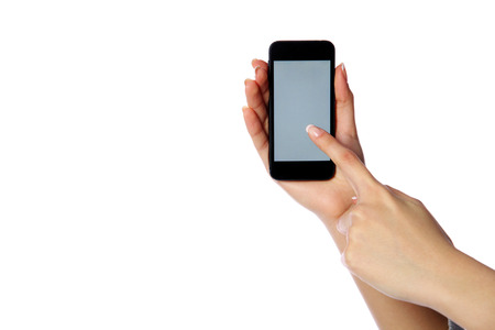 Closeup portrait of a female hands holding smartphone isolated on white background photo