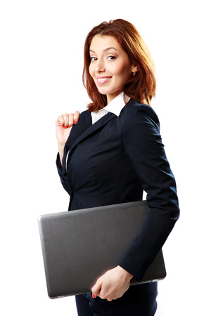 Happy businesswoman holding laptop isolated on white background photo