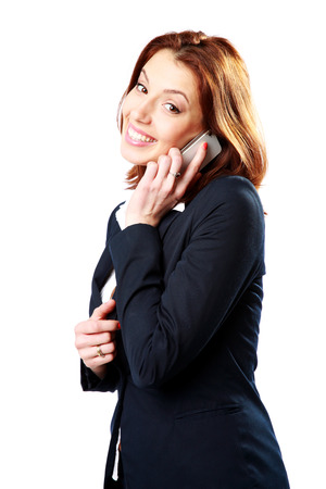 Happy businesswoman talking on the phone isolated on a white background photo