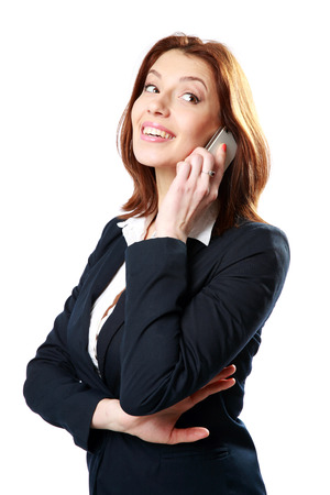 Smiling businesswoman talking on the phone isolated on a white background photo