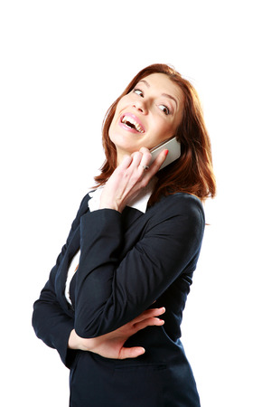 Laughing businesswoman talking on the phone isolated on a white background photo