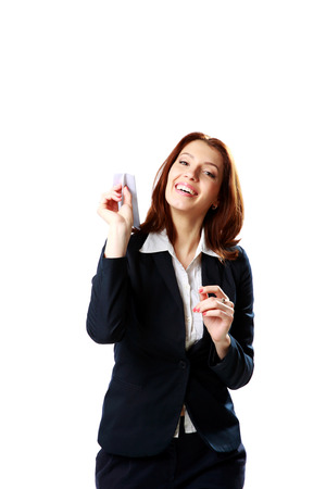 Happy businesswoman holding paper plane isolated on a white background photo
